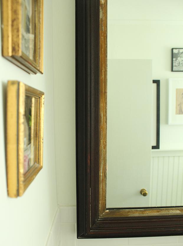 raised by design - bathroom renovation - gold frames